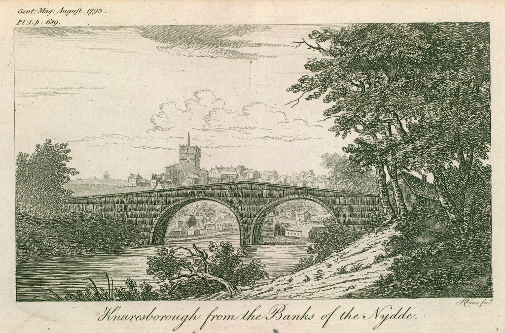 This etching shows a bridge over the River Nidd with trees and vegetation on the right bank. The town of Knaresborough can be seen in the background beyond the bridge.